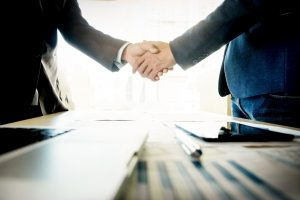Businessmen shaking hands during a meeting.