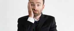 Closeup of procrastinating business leader