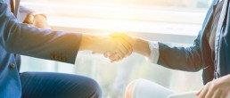 man and woman shaking hands to build trust