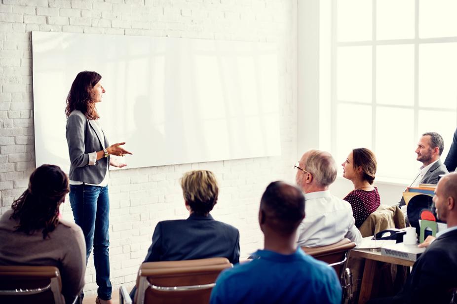 program design & assessment showing on whiteboard